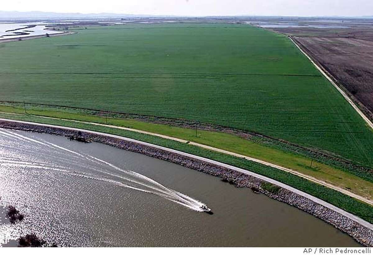 ** FILE ** A boat passes through the Sacramento-San Joaquin River Delta near Isleton, Calif., Feb. 25, 2001. Global warming will dramatically limit the availability of water in the West, including areas like the Sacramento-San Joaquin River Delta, according to a new study that Scripps Institute scientists bill as the rosiest of a series of recent climate forecasts for the already parched region. (AP Photo/Rich Pedroncelli, File)