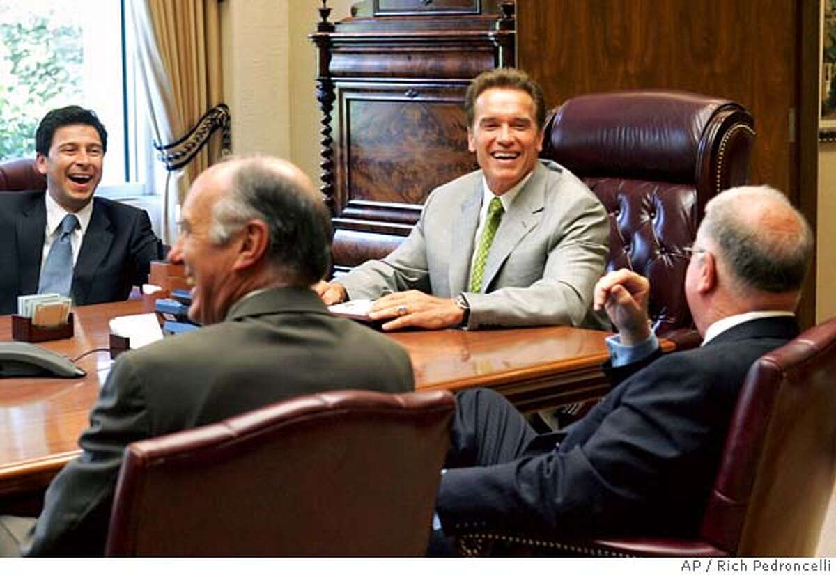Assembly Speaker Fabian Nunez, D-Los Angeles, left, state Senate Minority Leader Dick Ackerman, R-Fullerton, second from left and California Gov. Arnold Schwarzenegger, second from right, laugh at a comment made by state Senate President Pro Tem Don Perata, D-Oakland, right, before their meeting held to work on the state budget, at the Governor's Capitol office in Sacramento, Calif., Thursday, June 30, 2005. (AP Photo/Rich Pedroncelli) Ran on: 07-01-2005 Legislative leaders and Gov. Arnold Schwarzenegger make nice for photographers before getting down to budget business.