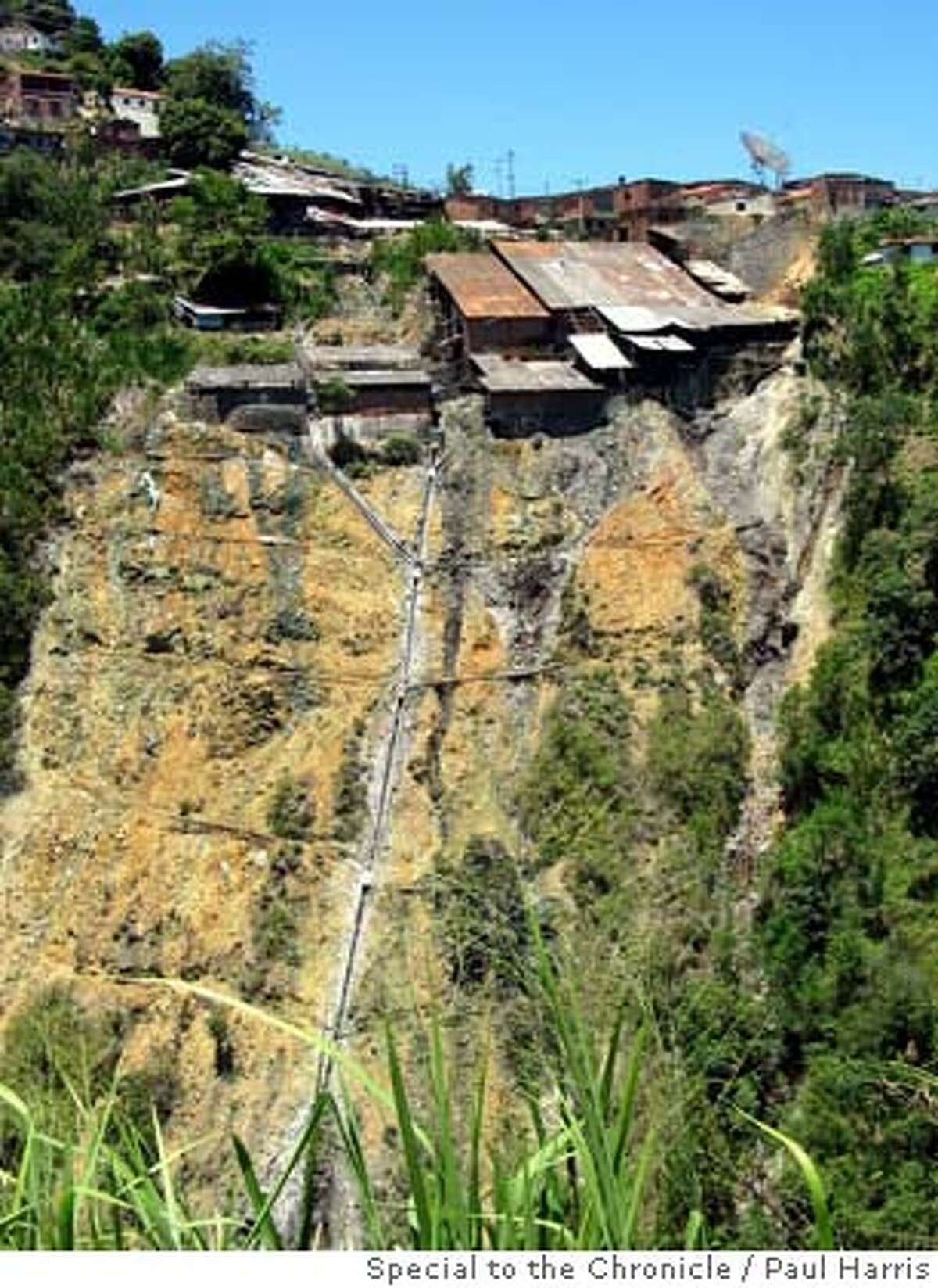 Toxic trail discharge from Marmato's largest mill.jpg Dumping of toxic mercury and cyanide used for gold recovery turns the green mountainside yellow in Marmato, Caldas. PAUL HARRIS/SPECIAL TO THE CHRONICLE NO MAGS, , NO TV