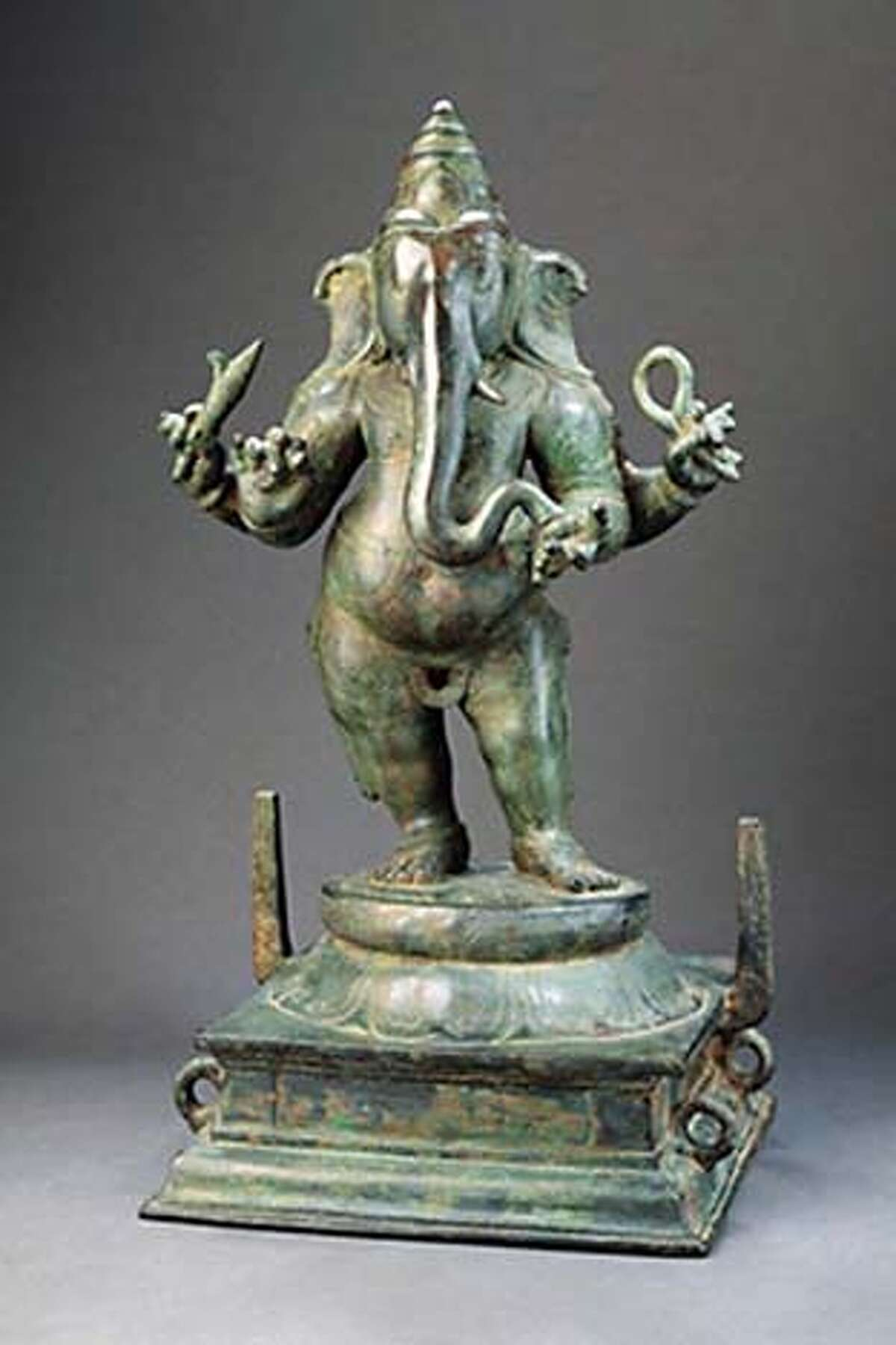 (NYT61) UNDATED -- JULY 21, 2005 -- ASIAN-SCULPTURE-EXHIBIT-3 -- A copper statue of the elephant-headed god Ganesha in an 11th-century Chola piece; in one of his hands he holds his own tusk, broken in battle, according to legend. Is is part of the exhibition �Images of the Divine: South and Southeast Asian Sculpture From the Mr. and Mrs. John D. Rockefeller 3rd Collection� at the Asia Society in Manhattan. The 50 sculptures in the show come from what is considered to be one of the finest small gatherings of such material in the United States. (Asia Society via The New York Times)