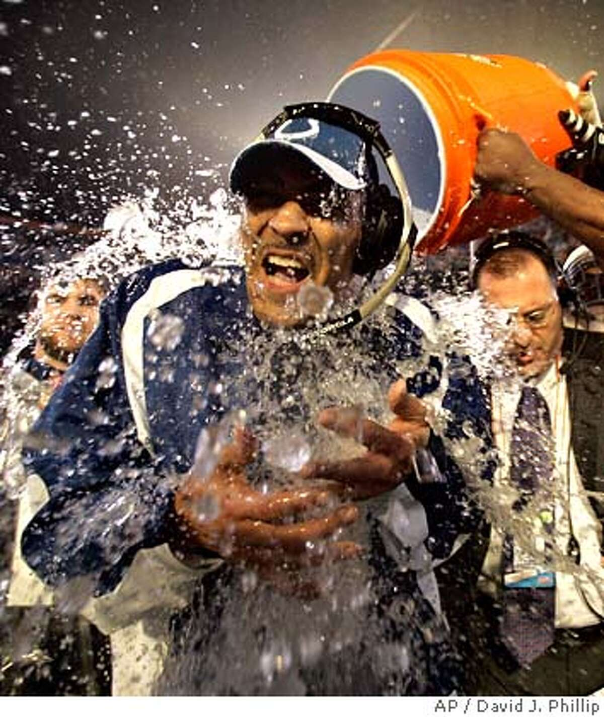 Indianapolis Colts coach Tony Dungy is dunked after the Colts defeated the Chicago Bears 29-17 in the Super Bowl XLI football game at Dolphin Stadium in Miami, Sunday, Feb. 4, 2007. (AP Photo/David J. Phillip)