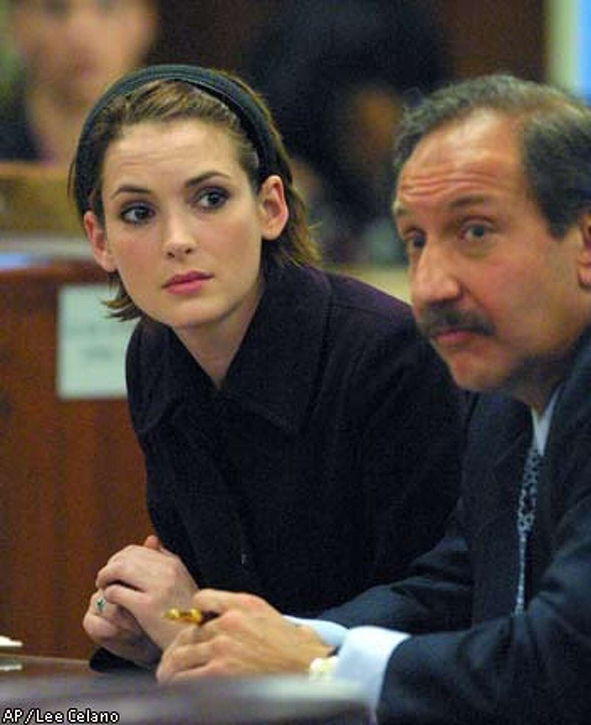 Actress , left, sits with her defense attorney Mark Geragos as the the verdict is read in her shoplifting trial Wednesday, Nov. 6, 2002, at the courthouse in Beverly Hills, Calif. The jury found Ryder guilty of felony grand theft and vandalism but cleared her of burglary charges. (AP Photo/Lee Celano, Pool)