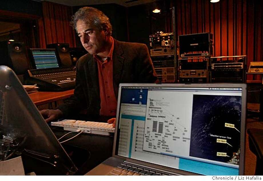 """STANFORDARTS_LH_074.JPG Stanford composer Jonathan Berger is using satellite images of an oil spill off the southern Lebanon coast to create a symphony, """"sonifying"""" the contours of the oil spill following patterns. He is working in the recording studio of Stanford's (CCRMA) center for computer research in music and acoustics. Photographed by Liz Hafalia MANDATORY CREDIT FOR PHOTOGRAPHER AND SAN FRANCISCO CHRONICLE/ -MAGS OUT Photo: Liz Hafalia"""