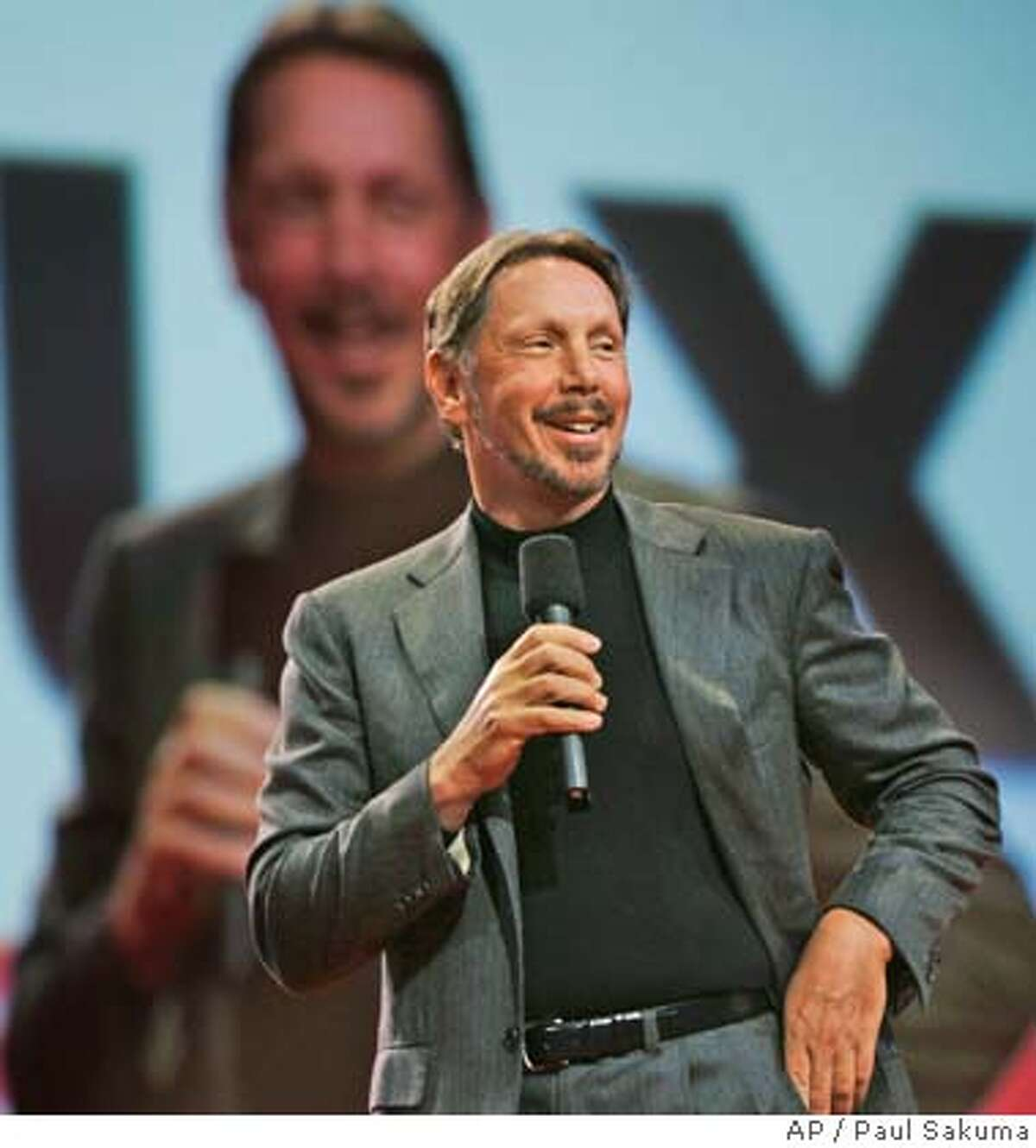 Oracle CEO Larry Ellison smiles during the Oracle Open World conference in San Francisco, Wednesday, Oct. 25, 2006. Oracle Corp. is scheduled to report fiscal second-quarter earnings after the bell. (AP Photo/Paul Sakuma) Ran on: 12-19-2006 Oracle CEO Larry Ellison says he wants to buy only those companies that will boost the bottom line by 20 percent a year.