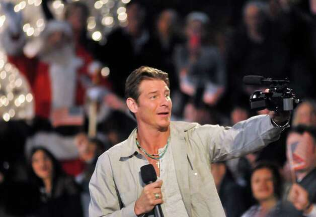 Slug: Extreme Home-No Photo Request number-January 19, 2012-San Antonio, Texas---Ty Pennington of the ABC show Extreme Makeover Home Edition talks to the crowd during the staging of a Red. White, and Blue Christmas parade on the Riverwalk at Arneson Theater. The show is building a house, in conjunction with Morgan's Wonderland, for wounded warrior Shiloh Harris of rural Floresville. Photo: Photo By Robin Jerstad/For The Express-News