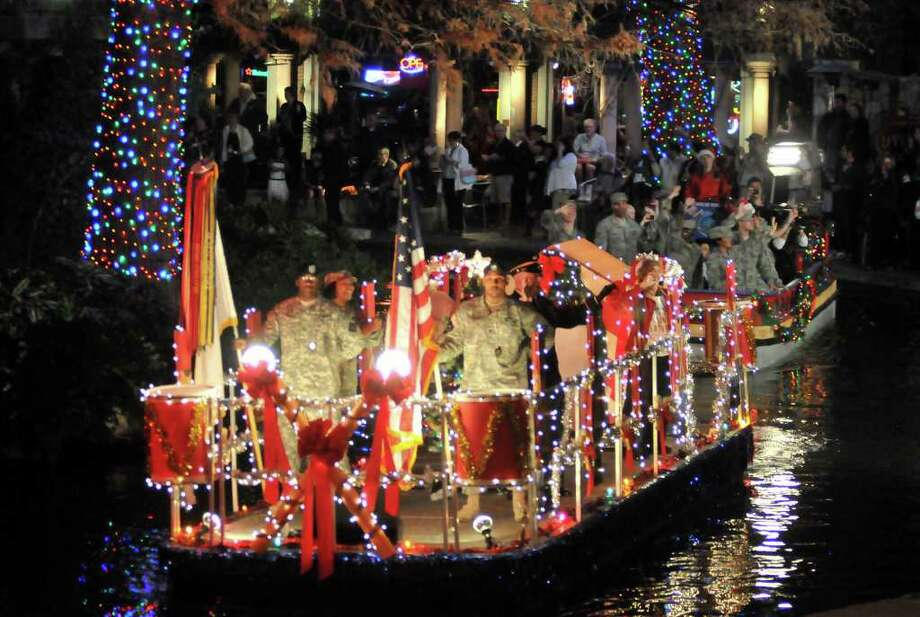 A military themed riverboat makes its way toward the Arneson Theater during the staging of a Red, White, and Blue Christmas parade for the ABC show Extreme Makeover Home Edition. The show will be broadcast in December of 2012. Photo: Photo By Robin Jerstad/For The Express-News