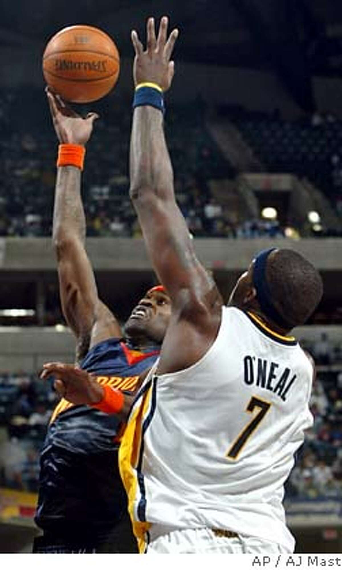 Golden State Warriors Stephen Jackson, left, shoots in front of Indiana Pacers' Jermaine O'Neal in the third quarter of an NBA basketball game in Indianapolis, Monday, Feb. 5, 2007. The Warriors won 113-98. (AP Photo/AJ Mast)