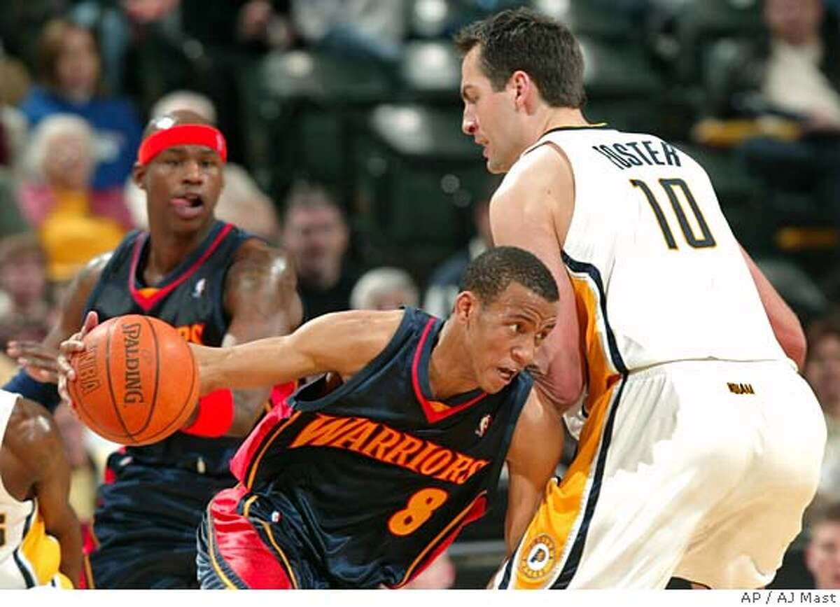 Golden State Warriors guard Monta Ellis, left, put his shoulder into the Indiana Pacers' Jeff Foster while dribbling in the second quarter of an NBA basketball game in Indianapolis, Monday, Feb. 5, 2007. (AP Photo/AJ Mast)