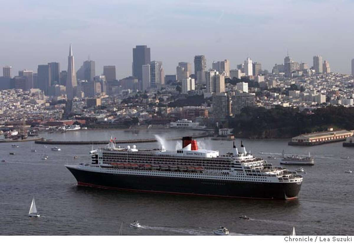 queen05_copter_498_ls.jpg The Queen Mary 2 sails through the Bay with San Francisco in the background. The Queen Mary 2 sails through the Golden Gate it's way to San Francisco on Sunday, February 4, 2007. Photo by Lea Suzuki/The San Francisco Chronicle Photo taken on 2/4/07, in San Francisco, CA. **(themselves) cq. Ran on: 02-05-2007 Queen Mary 2 sails under the Golden Gate Bridge to the sound of fog horns and the applause of onlookers gathered around San Francisco Bay. Ran on: 02-05-2007 The Queen Mary 2 sails under the Golden Gate Bridge to the sound of foghorns and the applause of onlookers gathered around San Francisco Bay.