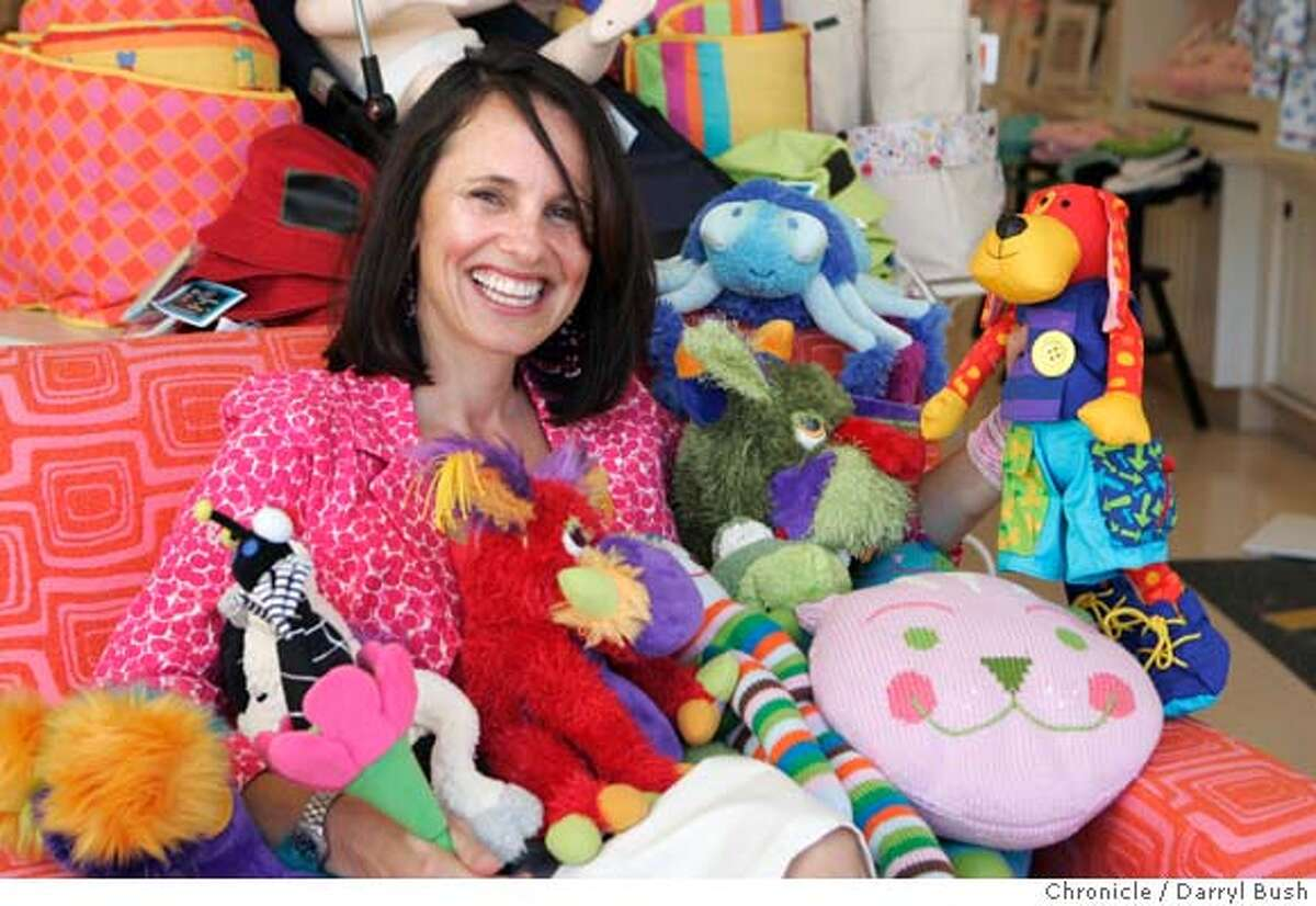 designers0731_059_db.jpg Alison Wing, founder and CEO of Giggle, surrounds herself with an assortment of puppets, toys, pillows, and dolls that the store sells at one of Giggle's stores on Chestnut St. Event on 6/28/05 in San Francisco. Darryl Bush / The Chronicle MANDATORY CREDIT FOR PHOTOG AND SF CHRONICLE/ -MAGS OUT