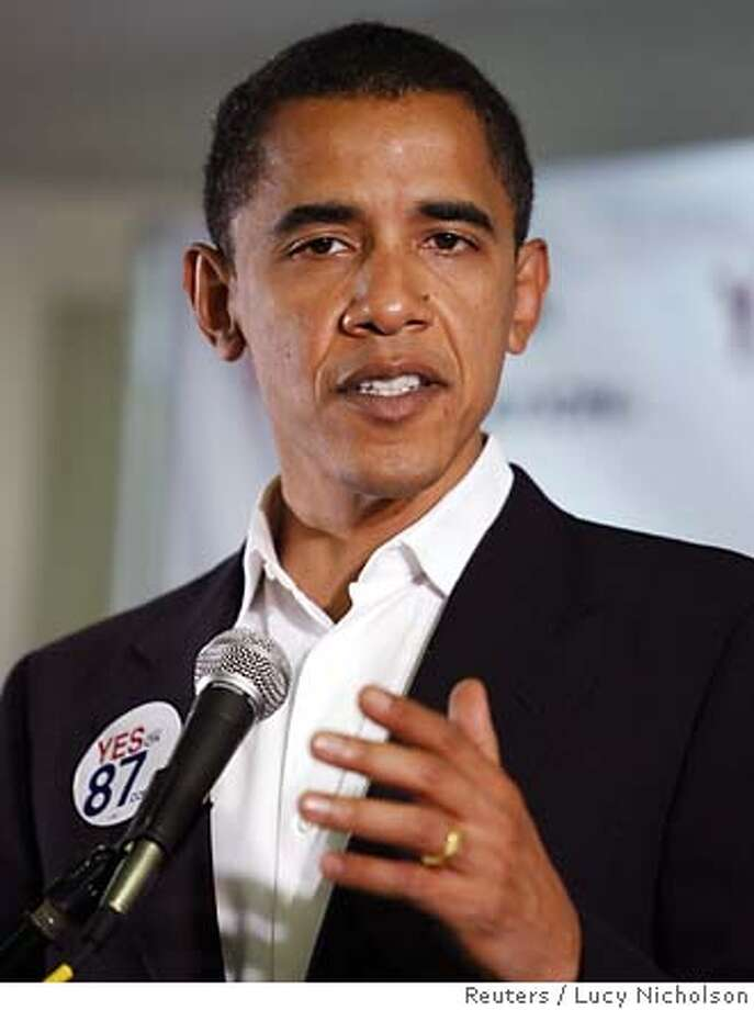 U.S. Democratic Senator Barack Obama (D-Ill.) speaks at a news conference in favor of Proposition 87, a ballot measure that attempts to break oil dependence with cleaner, cheaper alternatives such as wind, solar and biofuels, in Los Angeles, October 27, 2006. REUTERS/Lucy Nicholson (UNITED STATES)  Ran on: 11-05-2006  Dean Smith, the beloved retired men's basketball coach at the University of North Carolina, proclaims his Baptist background in Democratic politics and outlines in a newspaper ad how the two are entwined. 0 Photo: LUCY NICHOLSON