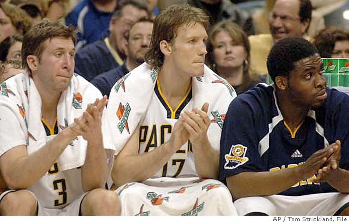 New Indiana Pacers', from left to right, Troy Murphy, Mike Dunleavy and Ike Diogu watch NBA basketball action against the New York Knicks at Conseco Fieldhouse in Indianapolis on Saturday Jan. 20, 2007. They were acquired in an eight-player trade with the Golden State Warriors on Jan. 17. Keith McLeod also was acquired in the trade, but did not dress for the game. (AP Photo/Tom Strickland)