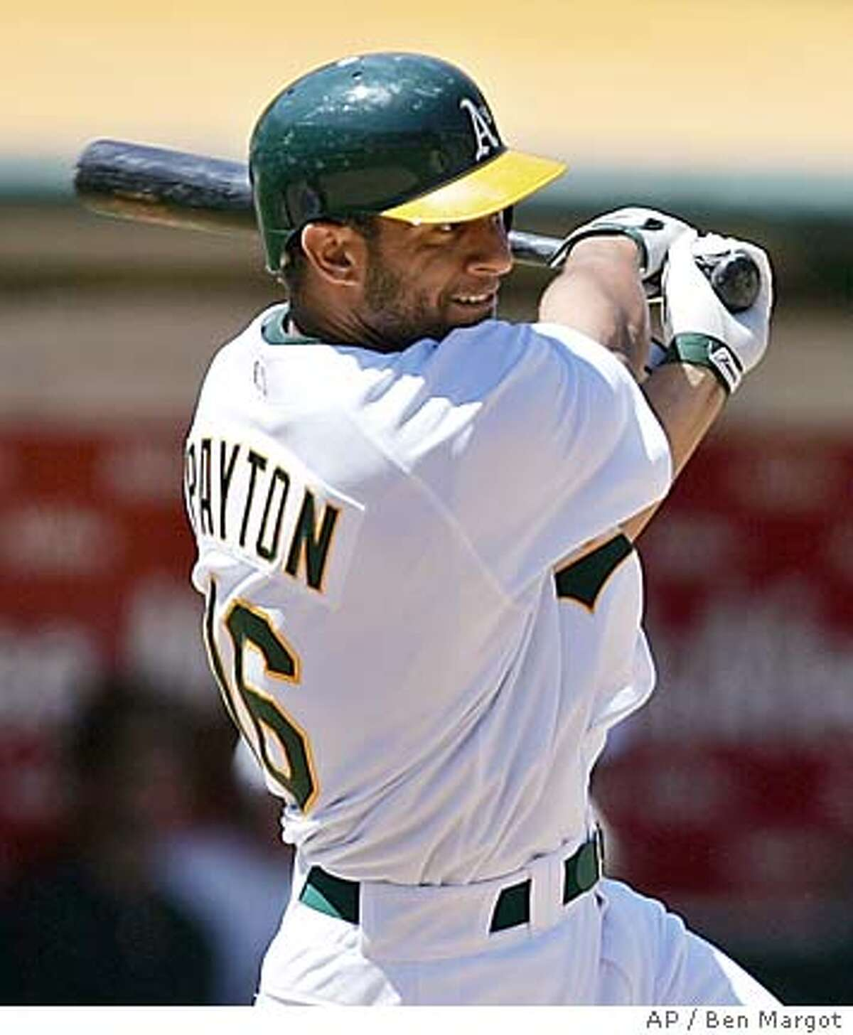Oakland Athletics' Jay Payton swings for an RBI single off Detroit Tigers' Nate Robertson in the fifth inning Saturday, July 30, 2005, in Oakland, Calif. (AP Photo/Ben Margot)