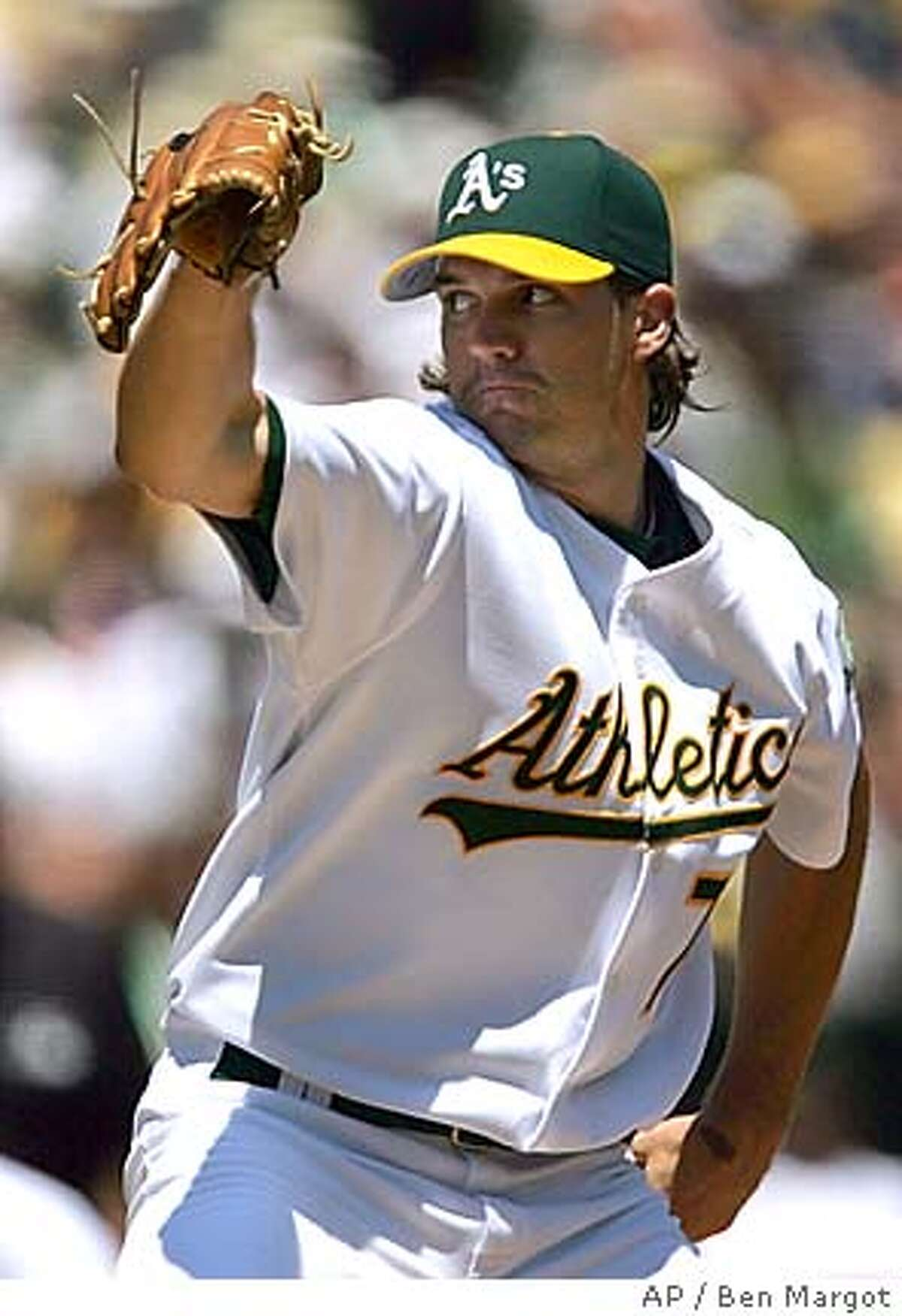 Oakland Athletics pitcher Barry Zito works against the Detroit Tigers in the first inning Saturday, July 30, 2005, in Oakland, Calif. (AP Photo/Ben Margot)