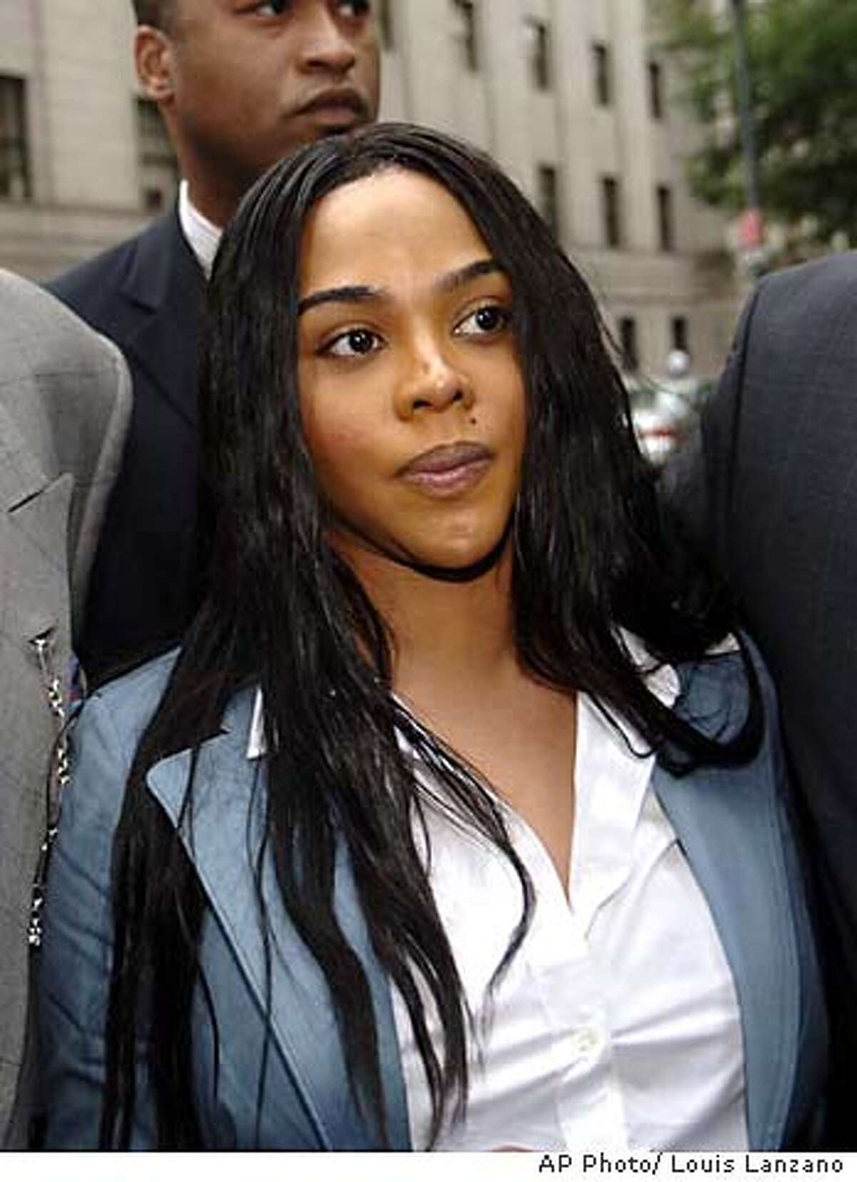 Lil' Kim whose real name is Kimberly Jones exits Manhattan federal court following her sentencing, Wednesday, July 5, 2005, in New York. Kim was given a one year and one day sentence and a $50,000 fine for lying to the grand jury in connection with a shootout outside a Manhattan radio station in 2001. (AP Photo/ Louis Lanzano)