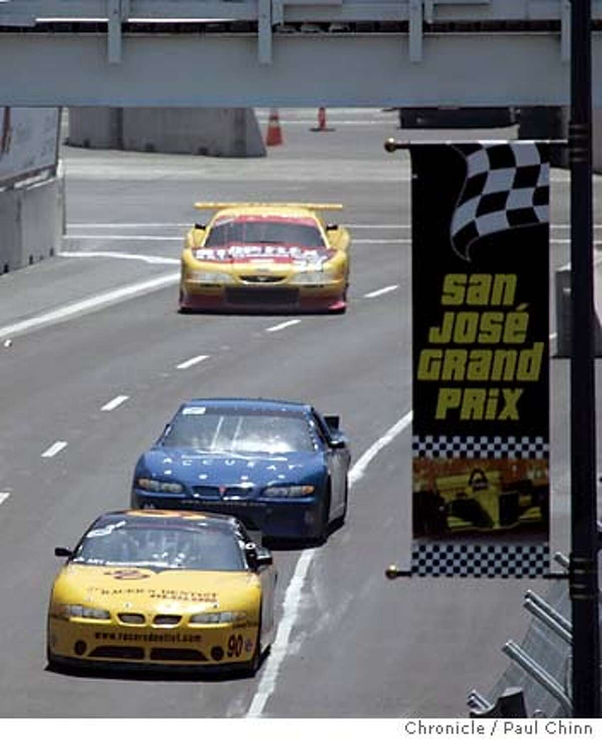 Trans-Am cars head up Almaden Blvd. towards the hairpin turn during a practice session for a preliminary race as seen from the third floor of Adobe Systems headquarters building. Practice and qualifying sessions for the inaugural San Jose Grand Prix Champ Car racing series on 7/29/05 in San Jose, Calif. PAUL CHINN/The Chronicle