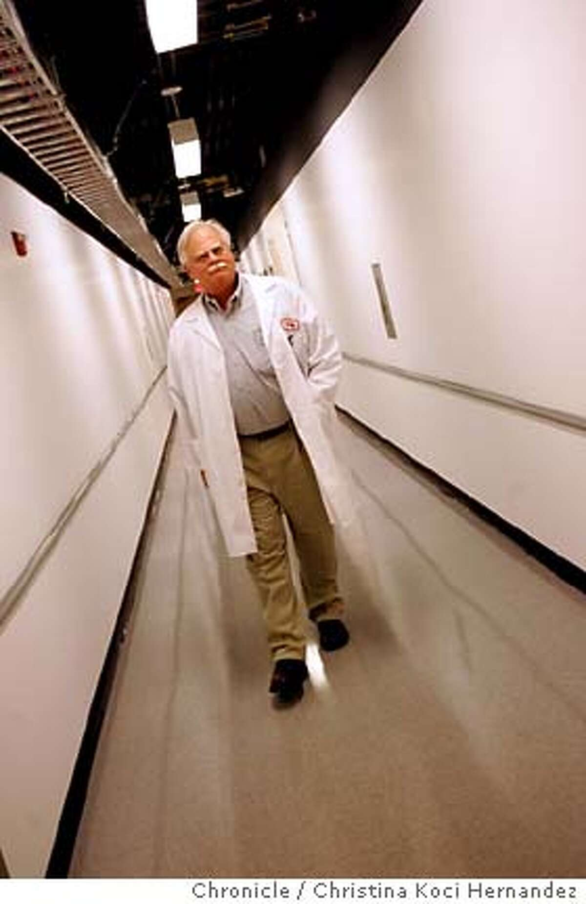 CHRISTINA KOCI HERNANDEZ/CHRONICLE Paul Duffy walks down the quiet corridors.Shortage of scientists at CALIFORNIA PUBLIC HEALTH LAB IN RICHMOND, 850 MARINA BAY PKWY.