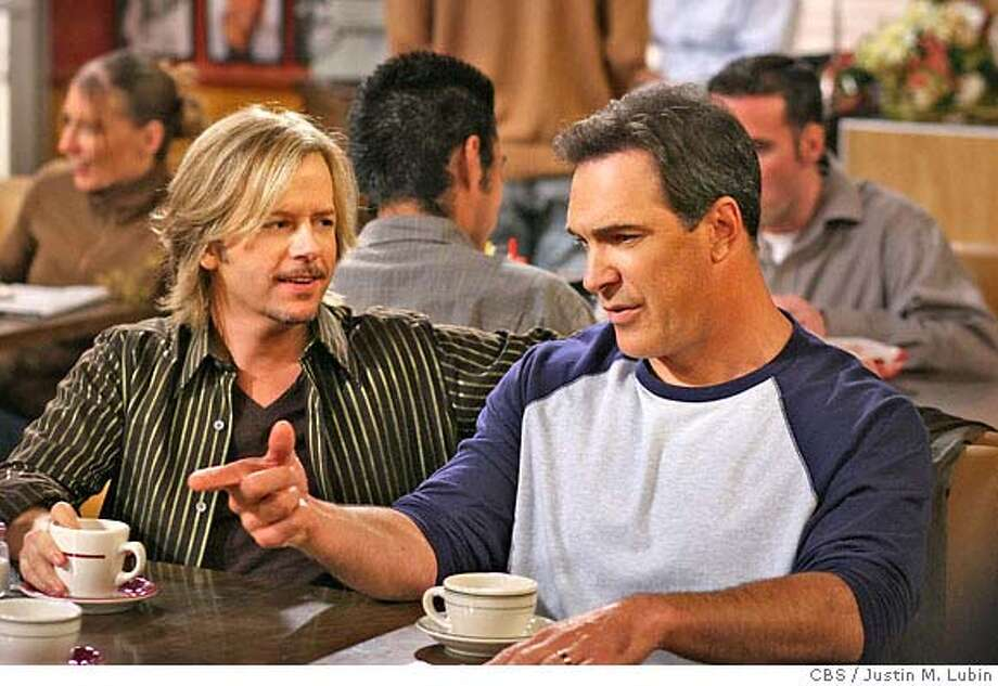 """The Young and the Restless"" -- Russell (David Spade) listens as Jeff (Patrick Warburton) makes a point on RULES OF ENGAGEMENT, Monday, Feb. 19 (9:30-10:00 PM, ET/PT) on the CBS Television Network. Photo: Justin M. Lubin/CBS �2006 CBS Broadcasting Inc. All Rights Reserved. MANDATORY CREDIT; ; NO ARCHIVE; NORTH AMERICAN USE ONLY Photo: JUSTIN M. LUBIN"