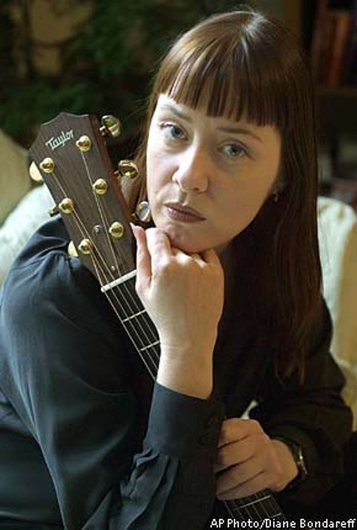 Singer-songwriter poses in her apartment Thursday, May 9, 2002, in New York. Vega collected songs by various artists about the Sept. 11 attacks for her new album,