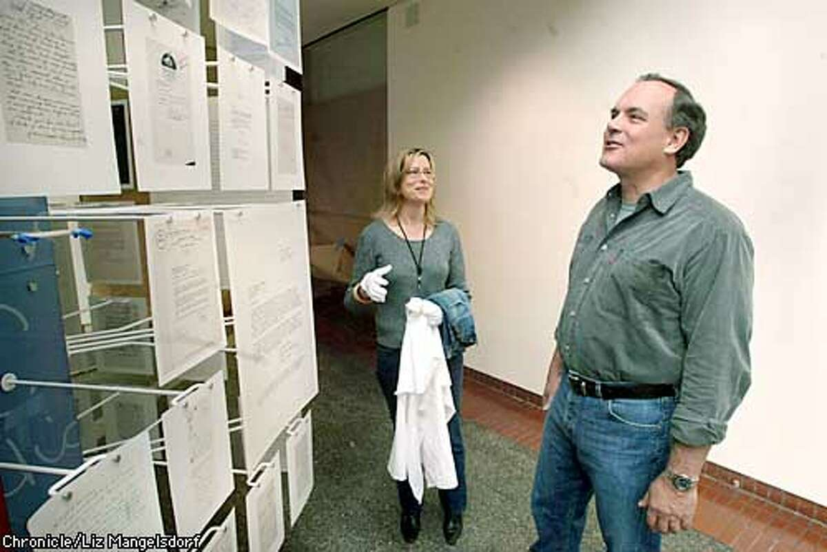Event on 4/25/03 in San Francisco. Levi Strauss & Co's CEO Philip Marineau, right, and Lynn Downey, Levi's company historian, look over the new visitor center at the Levi Plaza lobby, which is under construction and will be open to the public soon. LIZ MANGELSDORF / The Chronicle