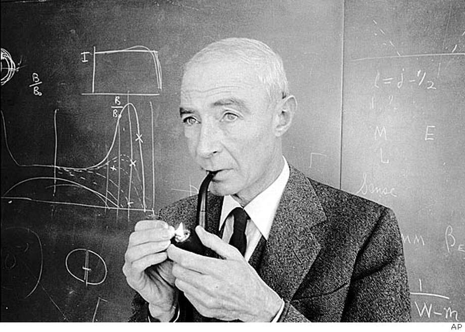 FILE-Atomic physicist Robert Oppenheimer lights up his pipe in Princeton N.J., in this 1963 file photo. Oppenheimer and other U.S. scientists gave the Soviets information on their efforts to build the first atom bomb, a retired Russian spy says in his memoirs quoted in the April 25th issue of Time magazine. `Since Oppenheimer, Bohr and Fermi were fierce opponents of violence, they would seek to prevent a nuclear war, creating a balance of power, through sharing the secrets of atomic energy,'' writes Pavel Anatolievich Sudoplatov in excerpts from ``Special Tasks: The Memoirs of an Unwanted Witness a Soviet Spymaster.'' (AP photo/File) ALSO Ran on: 07-17-2005  J. Robert Oppenheimer, who led the A-bomb project at Los Alamos, was a UC professor. CAT