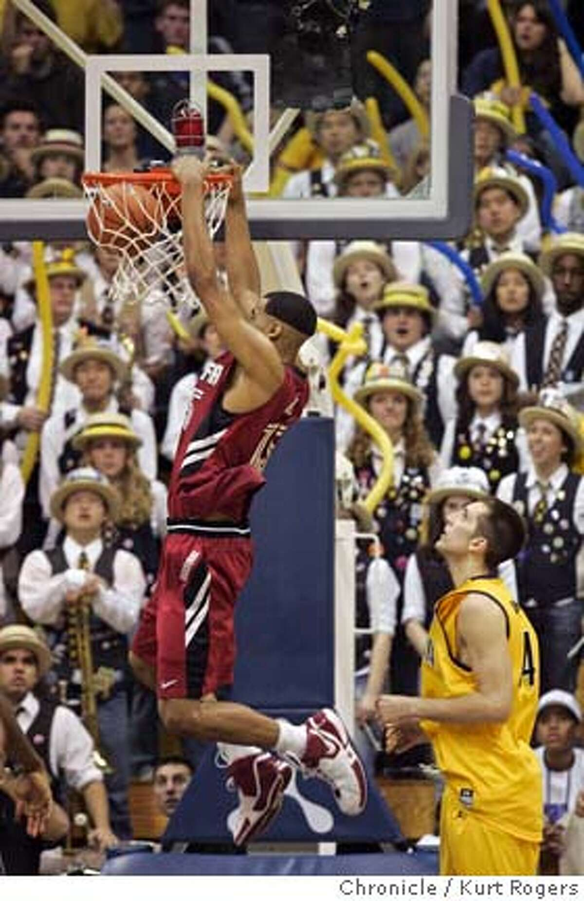 Lawrence Hill dunks the ball in front of the Cal Band as Ryan Anderson. In the second period of play Stanfiord 90 Cal 71 Stanford Cardinals vs California Golden Bears . SATURDAY, FEBRUARY 03, 2007 KURT ROGERS/THE CHRONICLE BERKELEY THE CHRONICLE SFC CAL_0953_kr.jpg Ran on: 02-04-2007 Stanfords Lawrence Hill emphatically slams in front of the Cal band while Ryan Anderson watches. Ran on: 02-04-2007 Stanfords Lawrence Hill emphatically slams in front of the Cal band while Ryan Anderson watches.