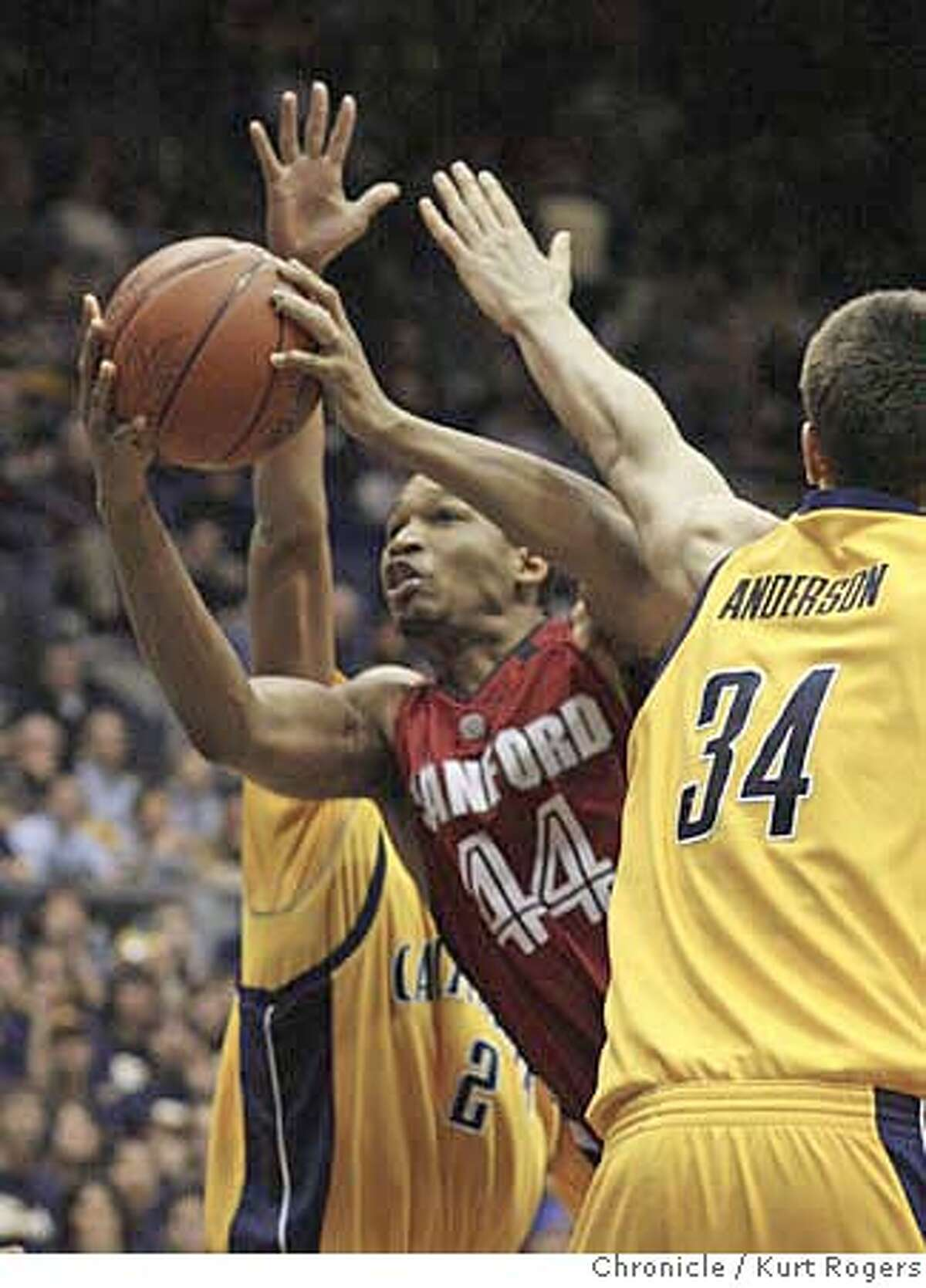 Stanford's Fred Washington scors two in the first half of play as Omar Wilkes and Ryan Anderson guard him. Stanford Cardinals vs California Golden Bears . SATURDAY, FEBRUARY 03, 2007 KURT ROGERS/THE CHRONICLE BERKELEY THE CHRONICLE SFC
