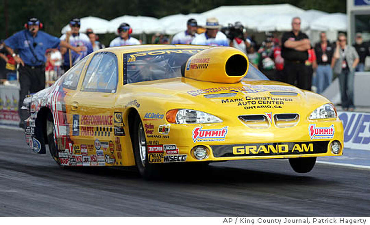 Warren Johnson takes off Friday, July 22, 2005, on his opening qualifying run at the NHRA's Conquest Auto Parts Nationals at Pacific Raceways in Kent, Wash. (AP Photo/King County Journal, Patrick Hagerty)
