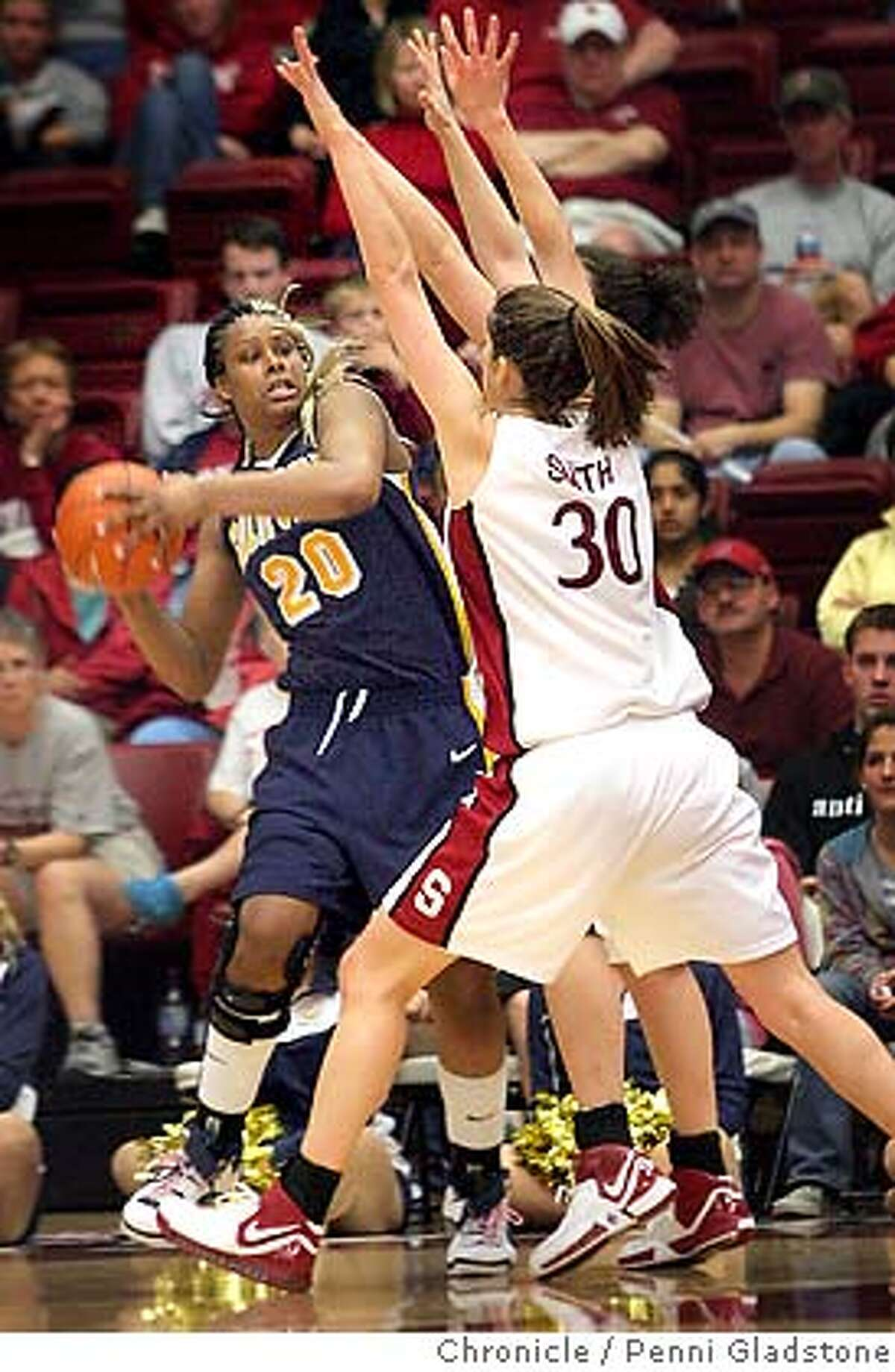 Stanford Cardinal vs California Golden Bears in basketball Bears Devanei Hampton tries to fend off Cardinal's Brooke Smith Event on 2/4/07 in Stanford. penni gladstone / The Chronicle