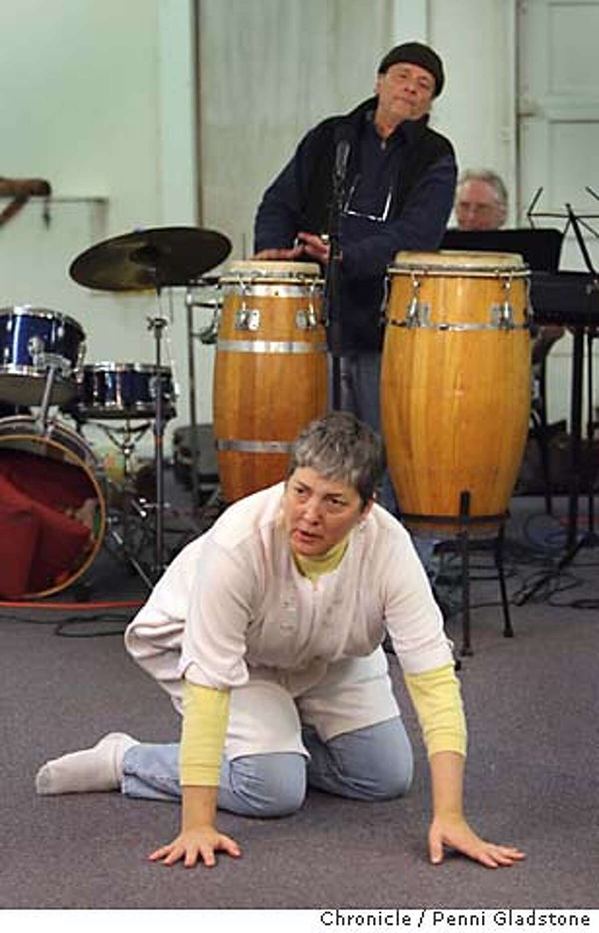 ERNST Actress Carla Spindt during rehearsal with Alternative Theatre Ensemble. In background on drums is Bob Ernst. They will present the world premiere of