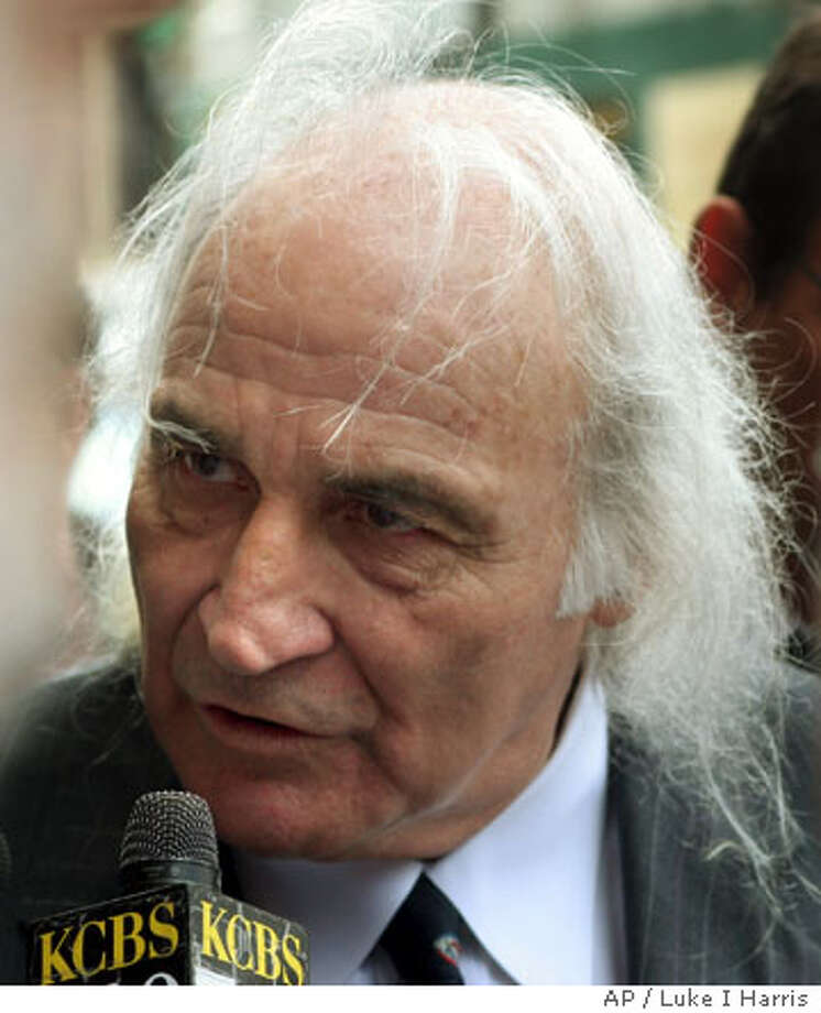 """Attorney J. Tony Serra speaks to the media after being sentenced to 10 months in federal prison for failing to pay his income tax Friday, July 29, 2005, in San Francisco. Serra, the civil rights lawyer who inspired the 1988 movie """"True Believer,"""" pleaded guilty Tuesday to two federal tax evasion charges. (AP Photo/ Luke I Harris) Photo: LUKE I HARRIS"""
