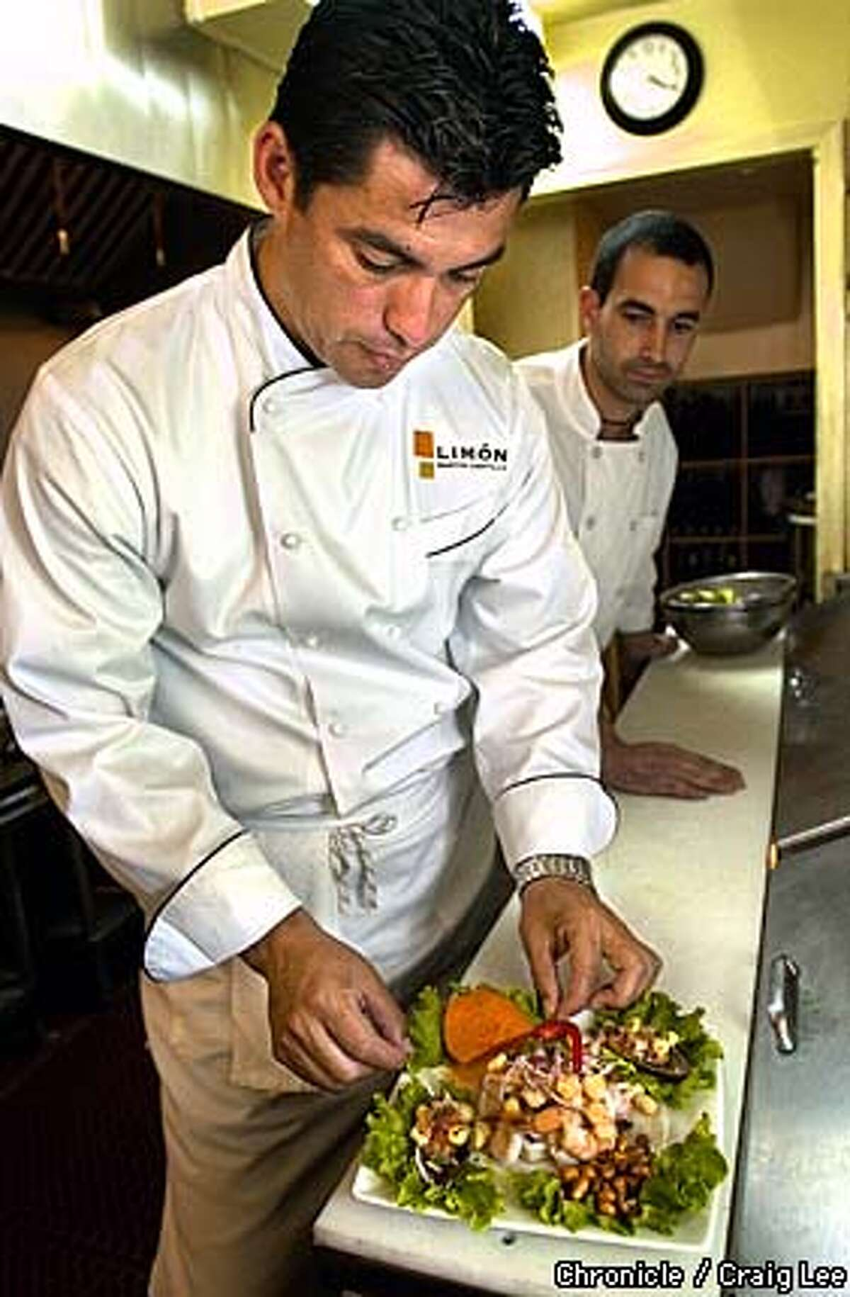 Latino restaurants are doing new types of ceviche that home cooks can do too. Chef Martin Castillo at Limon restaurant, 3316 17th Street. His recipes are Ceviche Limon and Tiradito de Pescado. Photo of Chef Martin Castillo making Ceviche Limon, his Sioux Chef, Eduardo Gutierrez, is at the right observing. Photo by Craig Lee/San Francisco Chronicle