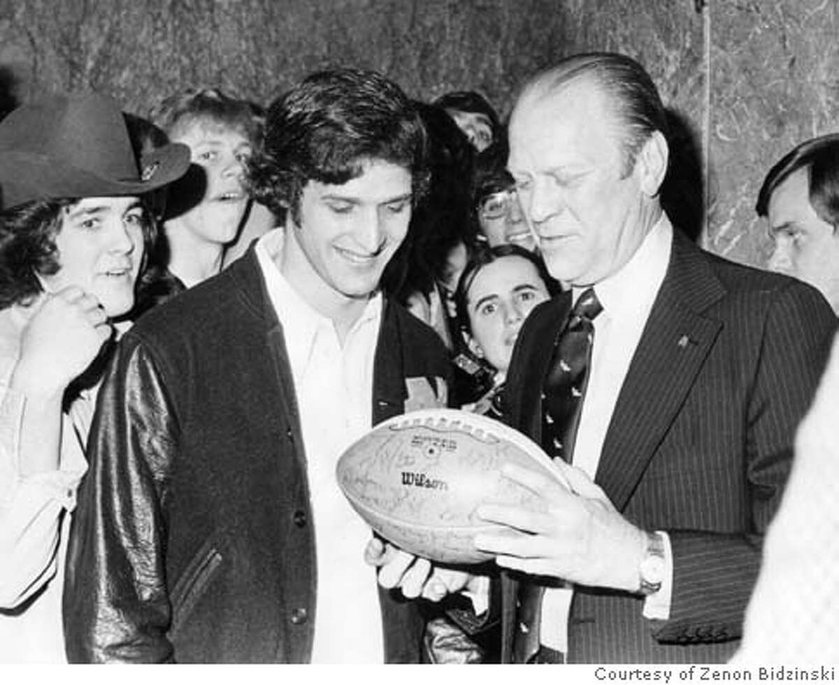 A young Frank Allocco (left), quarterback for the University of Notre Dame in 1975, gives an autographed football to President Gerald R. Ford March 17, 1975, during a visit to South Bend by the president. Frank Allocco is coach of the state champion De La Salle boys basketball team in Concord, CA. A former Notre Dame football player, he routinely turns a bunch of less-than-superstar talent into the smoothest-running, most efficient team around. Photo courtesy of Zenon Bidzinski (815-621-3246) MANDATORY CREDIT FOR PHOTOG AND SF CHRONICLE/ -MAGS OUT