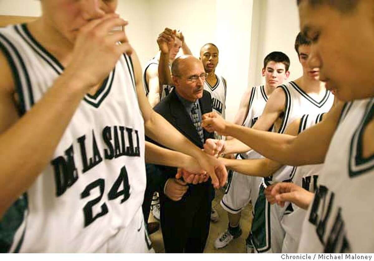 Coach Frank Allocco (center) rallies his team after his halftime pep talk in the locker room. Frank Allocco is coach of the state champion De La Salle boys basketball team in Concord, CA. A former Notre Dame football player, he routinely turns a bunch of less-than-superstar talent into the smoothest-running, most efficient team around. Tonight, Tuesday January 16, 2007, his team hosted and beat Brentwood's Heritage High School. Photo taken on 1/16/07 by Michael Maloney / San Francisco Chronicle MANDATORY CREDIT FOR PHOTOG AND SF CHRONICLE/ -MAGS OUT