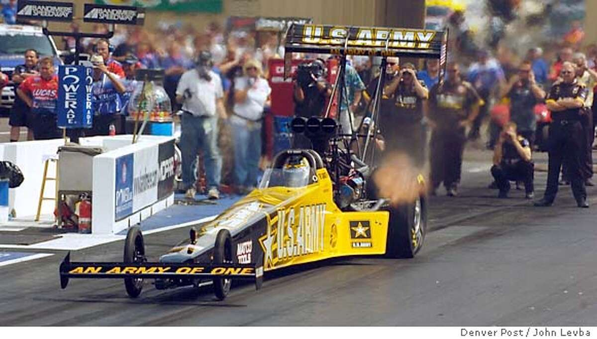 MORRISON, CO, JULY 16 , 2005 - Event and feature coverage of qualifying for the Mile High Nationals at Bandimere Speedway. Pro qualifying sessions are scheduled for 3 and 6 p.m. Need lead iconic photo for the Sunday sports section that shows speed. Please pan a top fuel dragster freezing the car, but blurring the fans etc. in the background. Also need a nice environmental portrait of team owner Don Schumacher.. (DENVER POST PHOTO BY JOHN LEYBA)