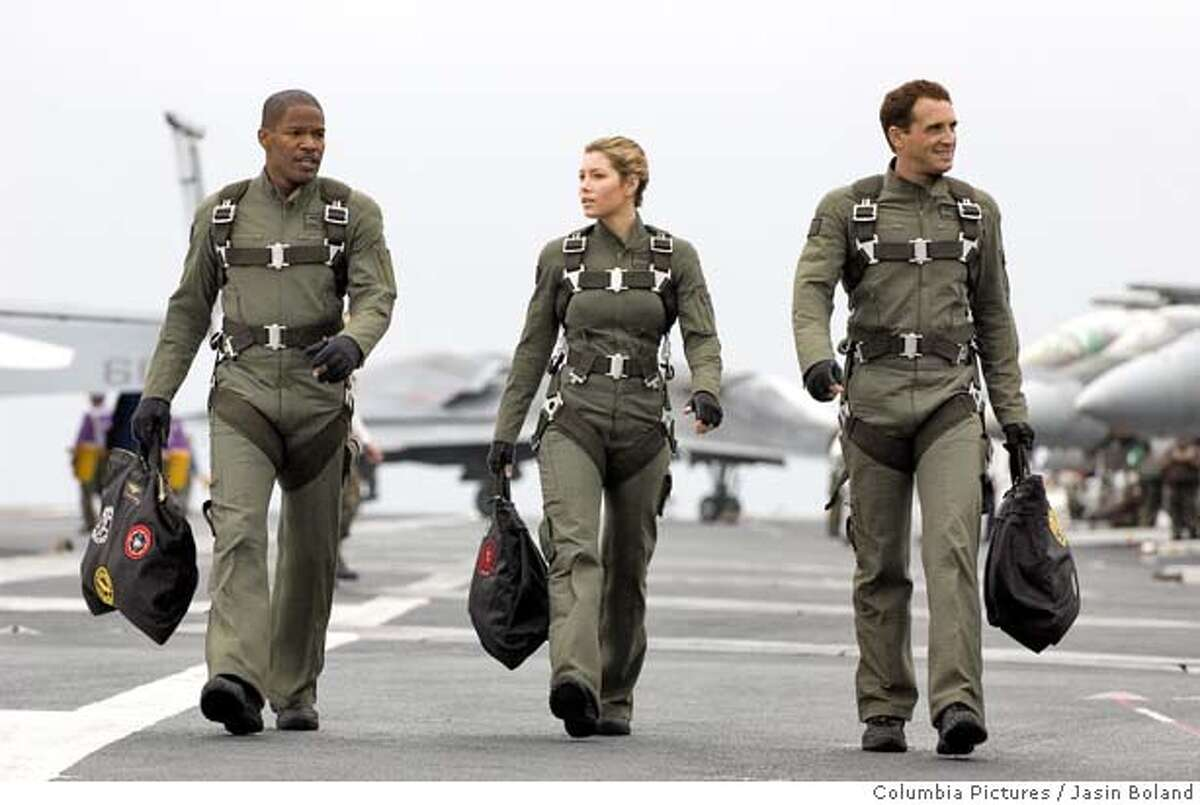 In this photo provided by Columbia Pictures, (left to right) Jamie Foxx, Jessica Biel and Josh Lucas star in the epic action adventure