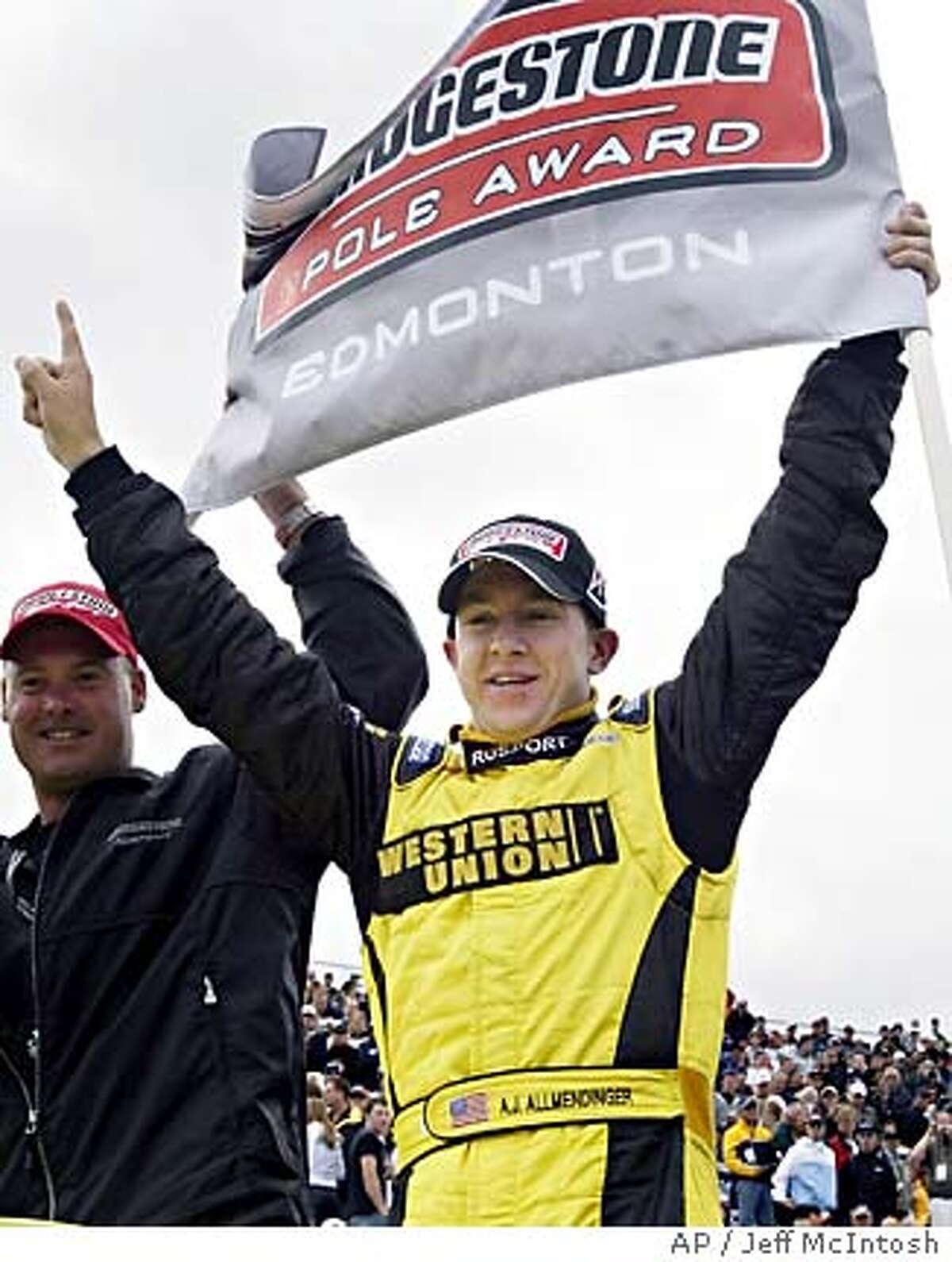 A.J. Allmendinger, right, of the United States, celebrates winning the pole position for the Grand Prix of Edmonton Champ Car race in Edmonton, Alta., Canada, Saturday, July 17, 2005.(AP Photo/Jeff McIntosh, CP)
