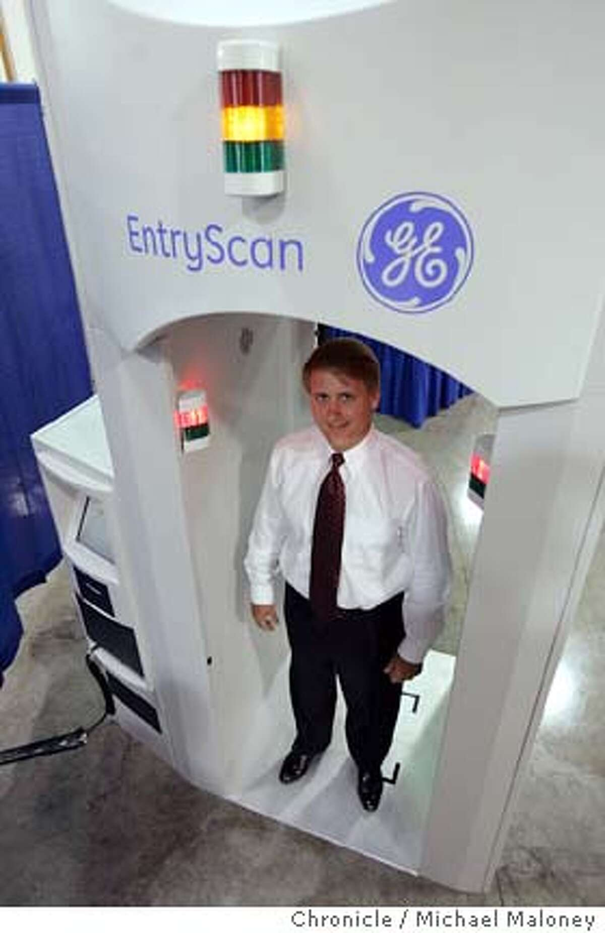 Dennis Cooke, president, GE Homeland Protection, demonstrates the company's non-invasive, walk-through security portal for high-traffic-volume checkpoint security applications, the EntryScan. The EntryScan is designed for use in airport, mass transit and large building and public-venue settings, among others. The EntryScan uses gentle puffs of air and patented technology to rapidly analyze microscopic particles for a variety of explosive materials and narcotics. Transit agencies around the Bay Area are grappling with how to increase security without taking the rapid out of transit. There are some newer technologies being developed by GE Infrastructure Security in Newark that offer faster screening. One is the EntryScan which blows a puff of air at a person walking through and measures that for explosive residue. Another is called the Itemiser FX which measures for explosive residue through a finger print. Photo by Michael Maloney / San Francisco Chronicle