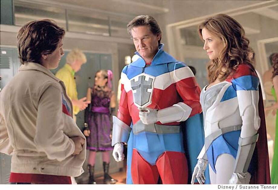 "(L-R) Actors Michael Angarano, Kurt Russell and Kelly Preston are shown in a scene from the Buena Vista Pictures release of ""Sky High,"" in an undated publicity photo released July 26, 2005. The film depicts a young superhero as he tries to find a balance between being a normal teenager and his destiny. ""Sky High"" opens in the U.S. July 29, 2005. /Suzanne Tenner/Disney Enterprises/Handout Photo: HO"