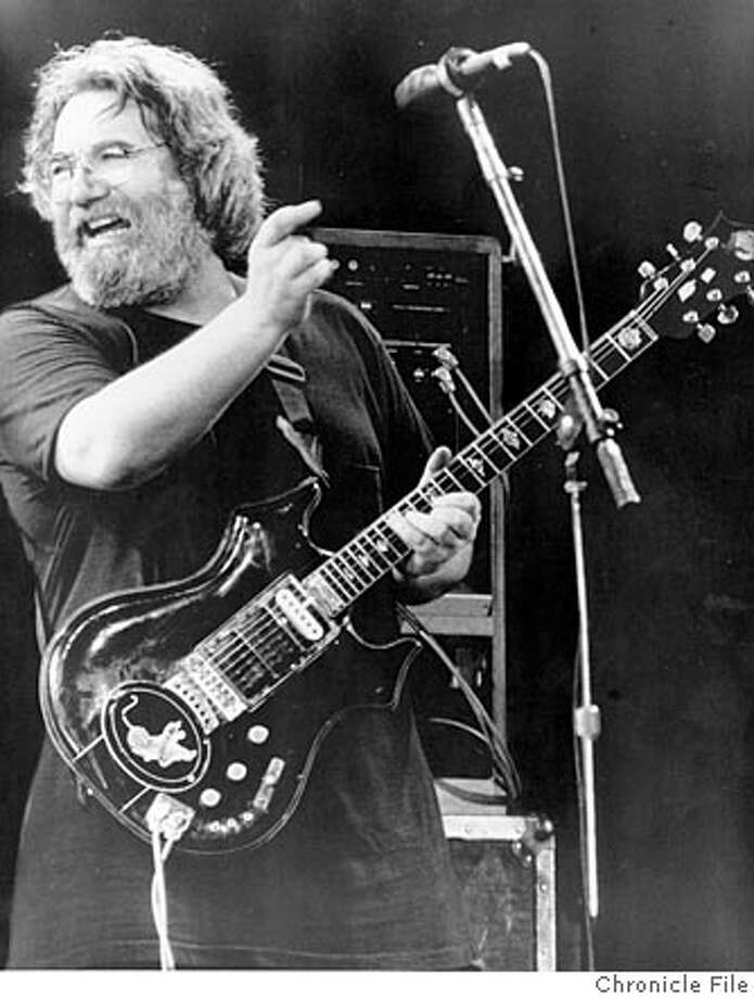 GARCIA06L-B-02NOV01-DD-HO Jerry Garcia plays his famous Tiger guitar during an undated concert believed to be from the mid- to late-80s. Chronicle file photo. ALSO RAN 4/27/02