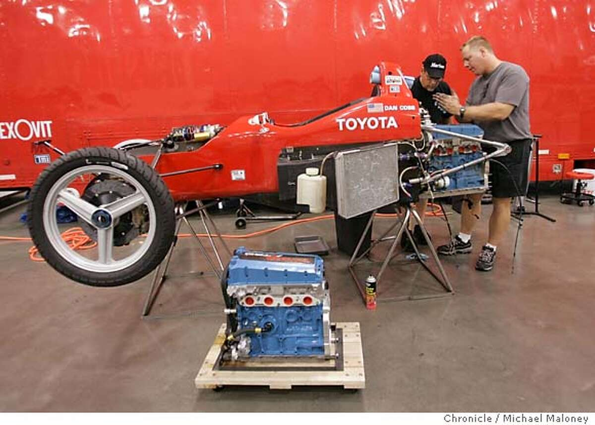 Owner/driver Dan Cobb (right) and mechanic Gary McDermott prepare to replace the engine on their Toyota Atlantic Championship race car. The city of San Jose prepares for the first Taylor Woodrow Grand Prix race this weekend. Hotels and restaurants are filling and the 1.5 mile downtown race course is taking shape. Photo by Michael Maloney / San Francisco Chronicle