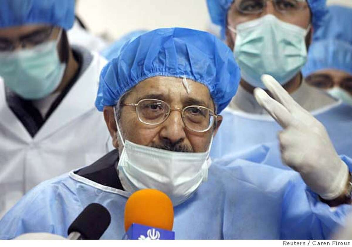 Iran's representative to the International Atomic Energy Agency, Ali Asghar Soltanieh speaks to journalists during a tour of the uranium conversion facility in Isfahan, 450 kilometers south of Tehran, February 3, 2007. REUTERS/Caren Firouz (IRAN) Ran on: 02-04-2007 An Iranian technician walks through the Uranium Conversion Facility as members of the media record the moment.