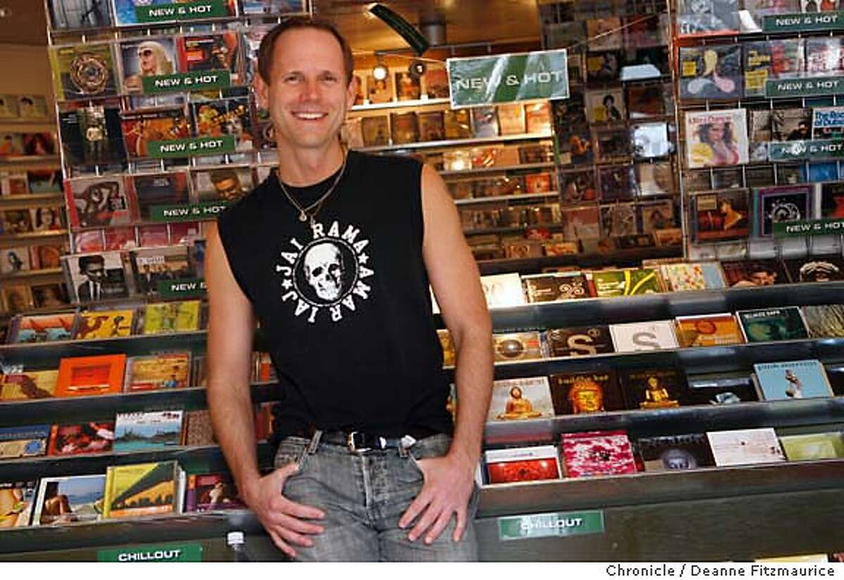 onthetown_wells_0098_df.jpg Rusty Wells, yoga teacher, is photographed in one of his favorite places in San Francisco, Medium Rare Records. Photographed in San Francisco on 1/23/07. Chronicle Photo / Deanne Fitzmaurice Ran on: 02-04-2007 Rusty Wells enjoys the vibe at Medium Rare Records in the Castro, a music store with a listening booth.