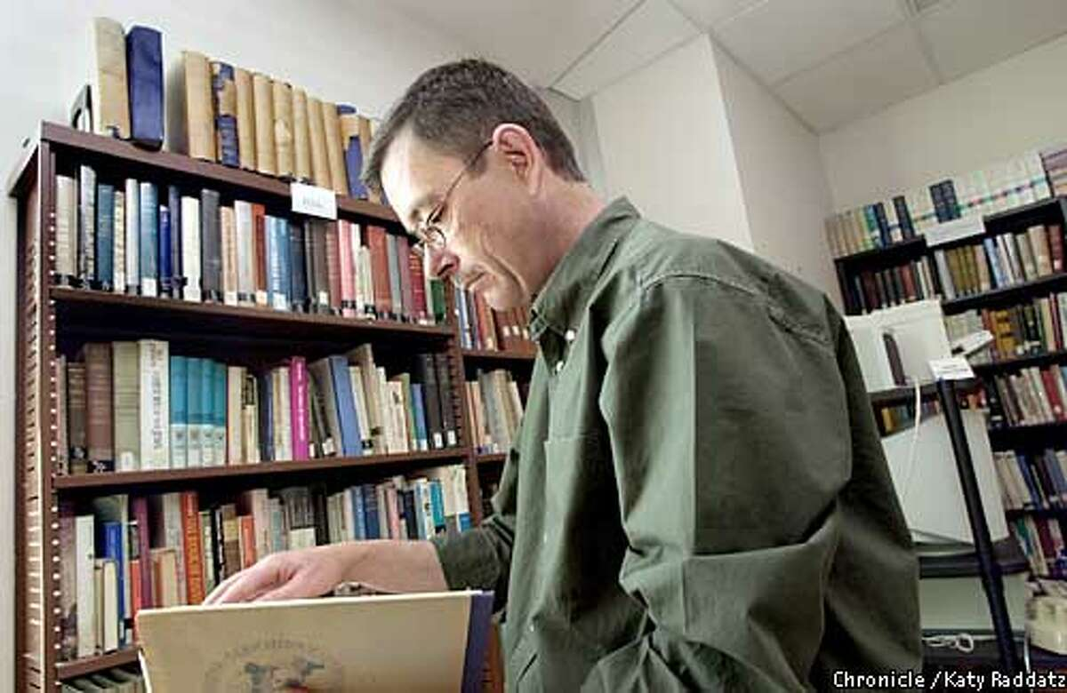 PHOTO BY KATY RADDATZ--THE CHRONICLE The Nuremberg Transcripts have been donated to San Francisco State. They're now in the Jewish Library in the Humanities. SHOWN: Tom Guynes, of the Dean's Office, takes a look at a volume.