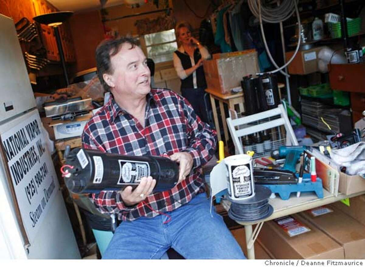 inventor_0048_df.jpg He is in his home workshop/garage. David Jewell, President of National Vapor Industries has invented a hydrogen powered device that affords fuel savings on cars and trucks. (Jewell's wife Pam is seen the background.) Photographed in Livermore on 1/10/07. Photo / Deanne Fitzmaurice Ran on: 02-03-2007 David Jewell made space in the garage of he and his wife, Pam, to build hydrogen-generating devices under the name National Vapor Industries. Ran on: 02-03-2007 Ran on: 02-03-2007 Ran on: 02-03-2007