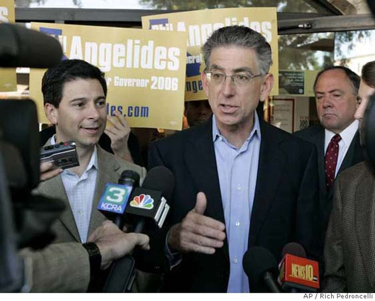 Democratic gubernatorial candidate state Treasurer Phil Angelides, right, speaks with reporters after visiting a Starbucks in Sacramento, Calif., Tuesday, Oct. 24, 2006. Angelides was accompanied by Assembly Speaker Fabian Nunez, D-Los Angeles, left. (AP Photo/Rich Pedroncelli) Ran on: 10-29-2006 Phil Angelides, speaking outside a Sacramento coffee house, has been described as a committed family man and traditional liberal Democrat.