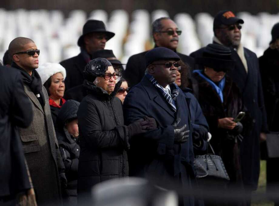 Jacqueline Weathers, widow of former Tuskegee airman retired Lt. Col. Luke Weathers, and others, watches her husband's casket arrive during burial services at Arlington National Cemetery in Arlington, Va., Friday, Jan. 20, 2012.  (AP Photo/Evan Vucci) Photo: Evan Vucci / AP