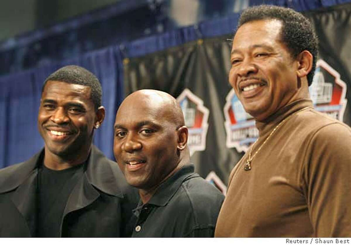 Former NFl players Michael Irvin (L), Thurman Thomas (C) and Charlie Sanders pose together after being elected to the Pro Football Hall of Fame at Super Bowl XLI in Miami, Florida February 3, 2007. REUTERS/Shaun Best (UNITED STATES) 0