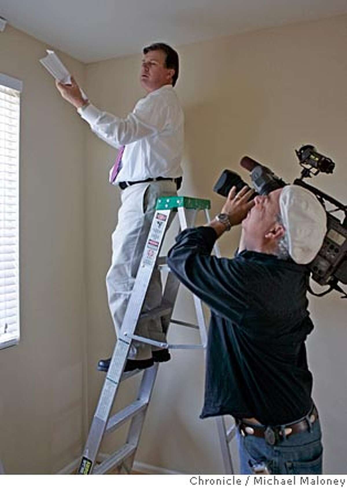 ABC camera operator Marc (cq) Sanchez-Corea (right) films Michael Finney on a ladder. Michael Finney, consumer affairs reporter for ABC 7�s �7 on Your Side,� tests do-it-yourself crown molding that�s made out of plastic, to see if it actually holds up. He and Hayward homeowner Rick Ali and his sister Ayisha Ali try to install the crown molding. Photo by Michael Maloney / San Francisco Chronicle