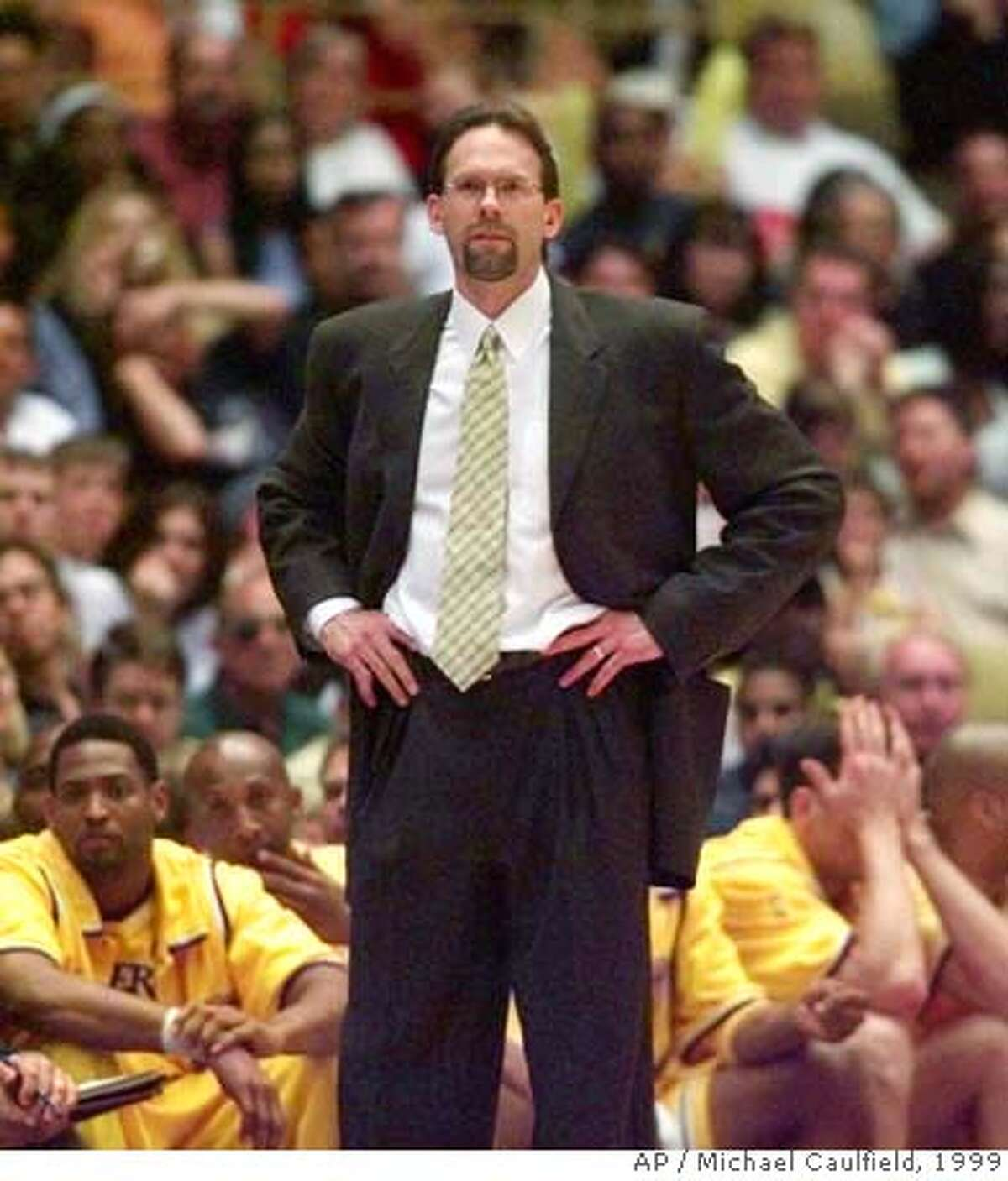 Los Angeles Lakers head coach Kurt Rambis watches his team down court during the closing seconds of game four of the Western Conference semifinals against the San Antonio Spurs at the Great Western Forum in Inglewood, Calif., Sunday, May 23, 1999. The Spurs won 118-107 to sweep the series. (AP Photo/Michael Caulfield) DIGITAL CAMERA IMAGE
